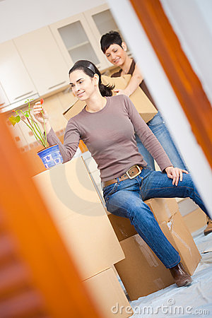 Woman sittin on cardboard box