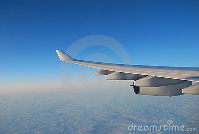 Airplane wing and blue sky