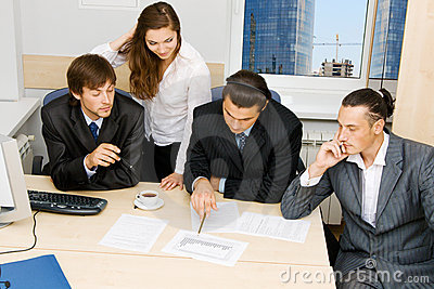 Office workers having a discussion