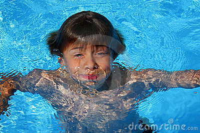 Boy having fun in swimming pool