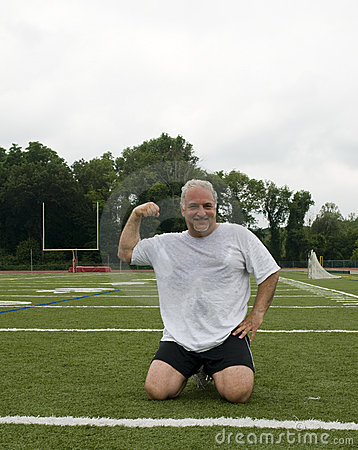 Middle age man exercising sports field