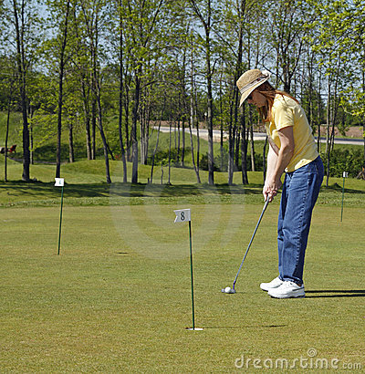 Lady On Golf Putting Green