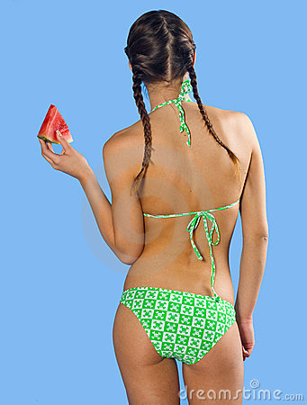 Girl in swimsuit with watermelon