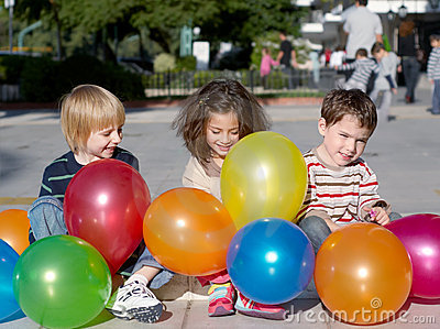 Friends with multi-coloured inflatable spheres