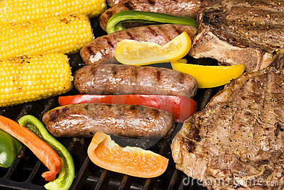 Barbecued steak, bratwurst and corn on the cob
