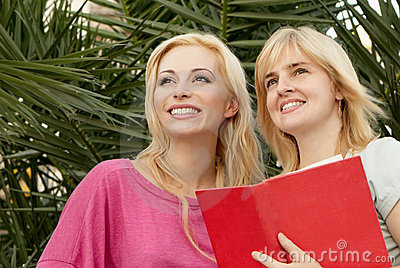 Two young girls with the book
