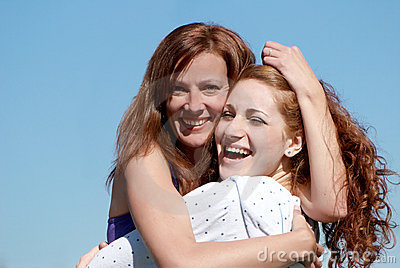 A young happy girl with mother