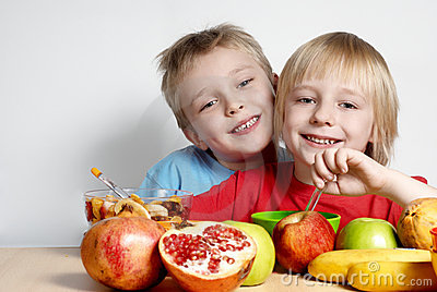 Two small friends with fruit