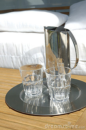 Water jug and glasses by bed