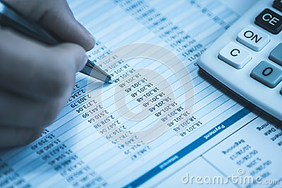 Accountant in accounting. Spreadsheet with human hand holding pen and calculator in business blue. Stock balance sheet