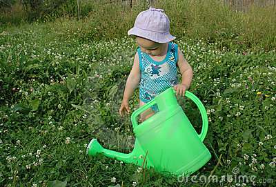 Litlle girl and watering-pot