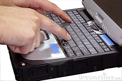 Finger typing on laptop