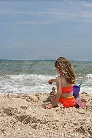 Girl building sand castle 1