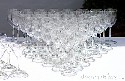 Rows of wine glasses waiting to be used