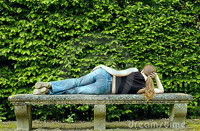 Sexy woman lying on the bench