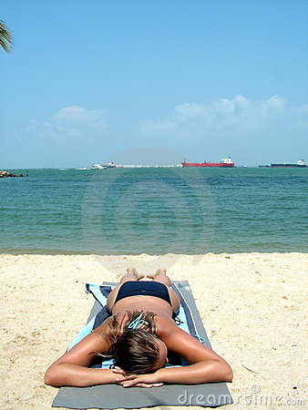 Topless suntanning at beach