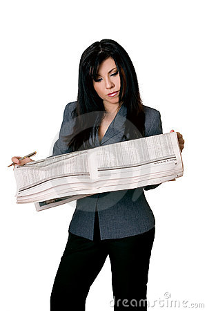 Woman with open newspaper reading.