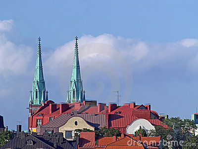 Roofs and church towers at sunset