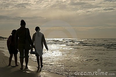 family walk on beach