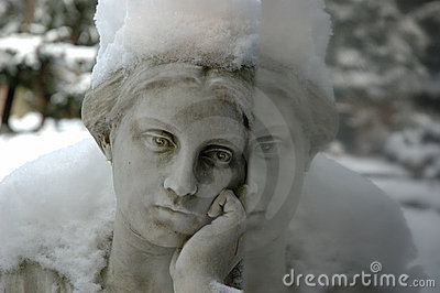 Angel with snow thinking about dead with reflection
