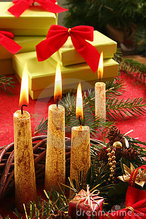 Christmas candle and gifts