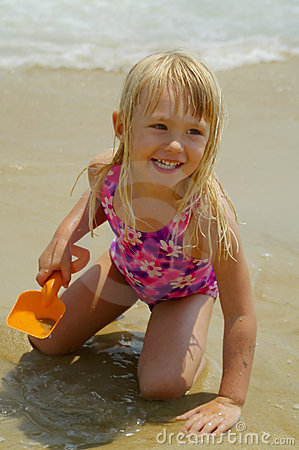 Happy Little Girl Playing at the Beach