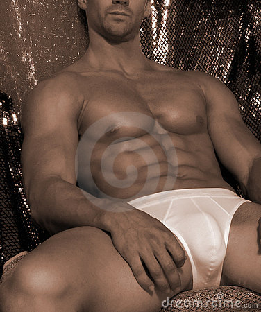 Seated  male with great abs