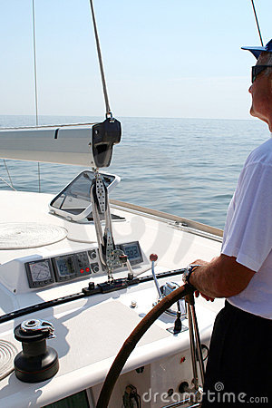 Captain beyond the yacht steering
