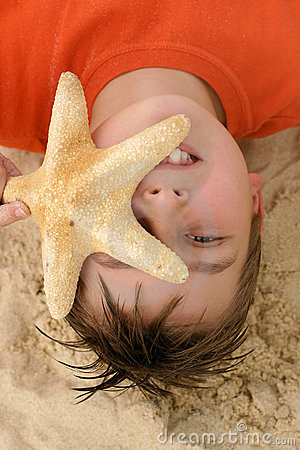 Child with a large starfish