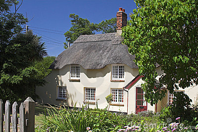 Cream thatched cottage in garden setting
