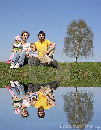 Family with birch and water