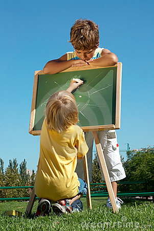 Two boys drawing outdoor