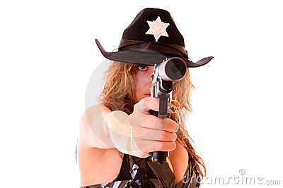 Beautiful sheriff woman shooting with gun isolated