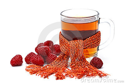 Cup of tea with raspberry