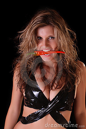 Beautiful woman with red pepper on black