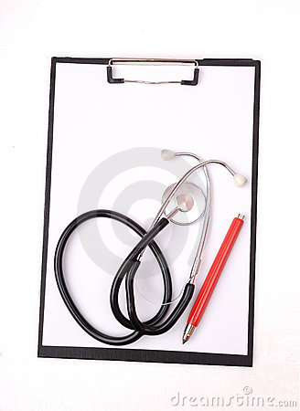 Clipboard, stethoscope and red pen