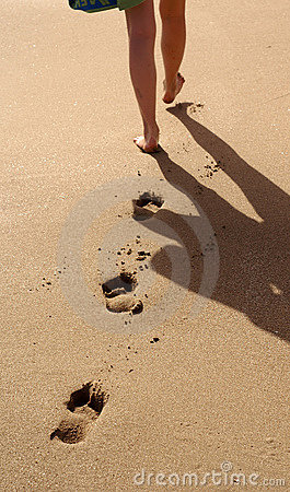 girl foot prints in the sand