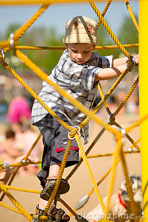 Boy on yellow ropes