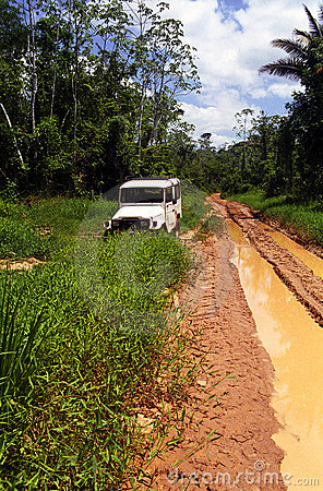 SUV in a muddy trail in the amazon forest