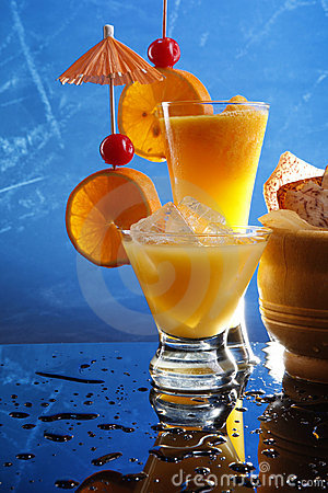 Orange cocktails on blue