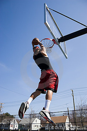 Man Dunking the Basketball