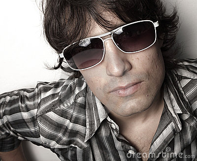 Headshot of a man with sunglasses