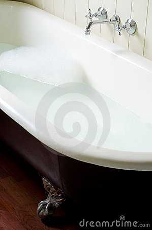 Old bath tube with bubbles