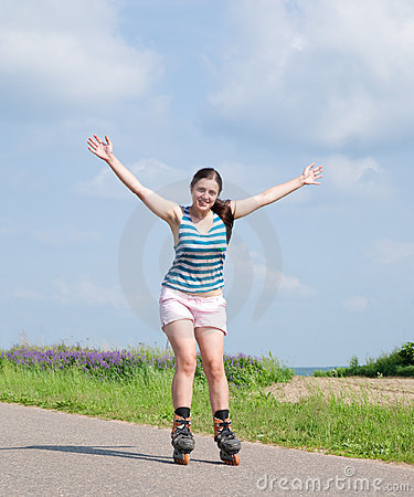 Young woman on roller blades