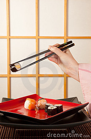 Serving sushi with chopsticks