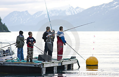 Boys fishing on fjord