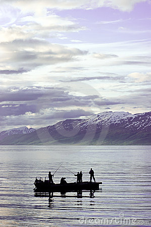 People fishing on fjord