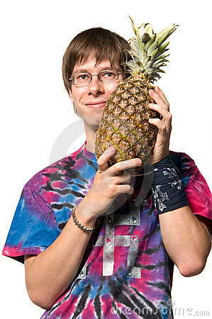 Young man with pineapple