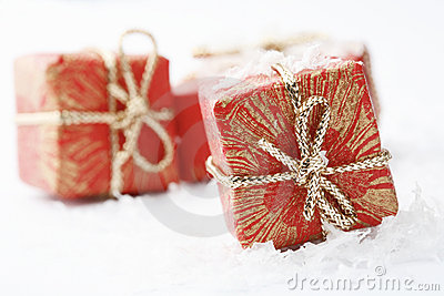 Christmas gifts with red wrapping and bows.