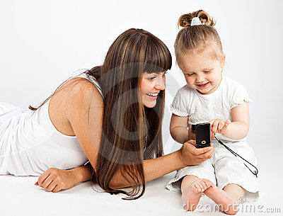 Mother  and little daughter speaking by phone